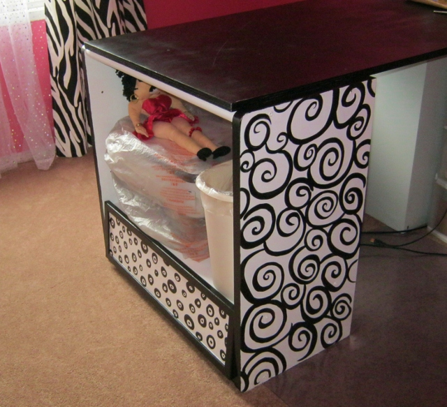 After Photo: Cabinet With Black And White Swirls And Dots