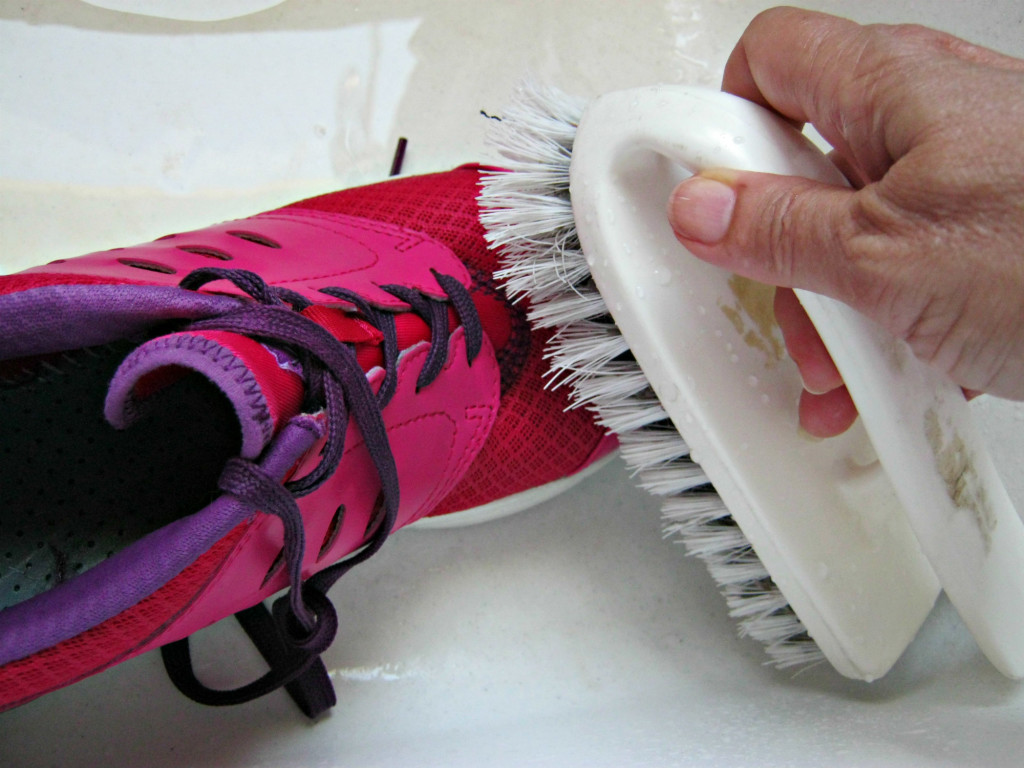 Cleaning shoes with scrub brush